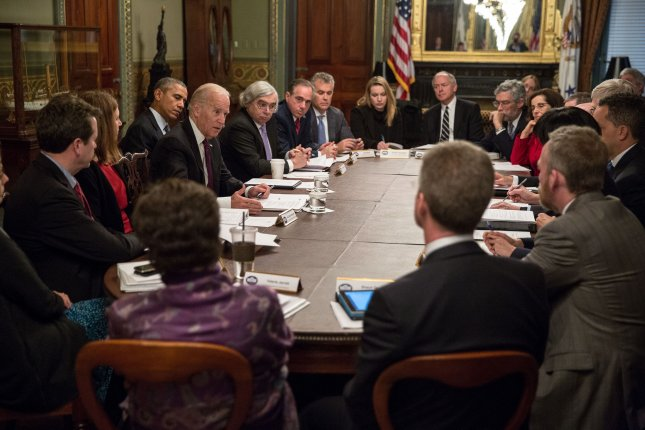 President Barack Obama and Vice President Joe Biden participate in a meeting with the White House Cancer Moonshot Task Force in the Vice President's Ceremonial Office in the Eisenhower Executive Office Building of the White House, Feb. 1, 2016. Photo by Pete Souza/White House/UPI
