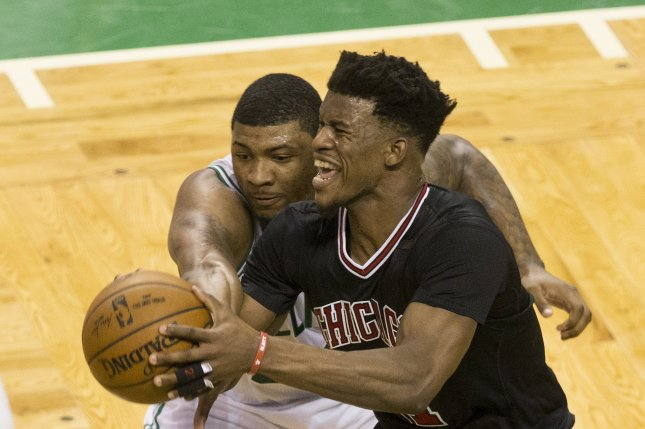 Chicago Bulls forward Jimmy Butler (R) keeps the ball away from Boston Celtics guard Marcus Smart (L) during the first half of their NBA Eastern Conference first round playoff series game at the TD Garden Sunday in Boston, Mass. File photo by C.J. Gunther/EPA