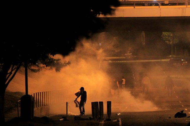 Human rights activists and opposition groups denounced a 6 p.m. to 6 a.m. curfew in the country following protests of its controversial presidential election in which both candidates declared victory. Photo by Gustavo Amador/EPA
