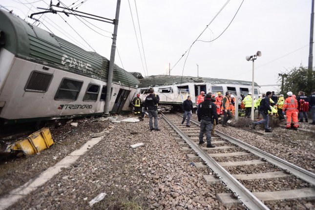Rescuers help people after a train derailed near Milan, Italy. Photo by Flavio Loscalzo/EPA