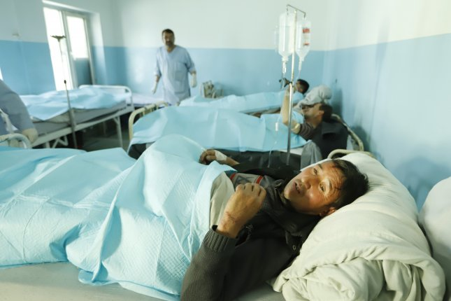 Wounded men receive medical treatment in a hospital after several mortars targeted a political gathering in downtown Kabul, Afghanistan in March. The United Nations sounded an alarm Monday about an increase in civilian deaths. File Photo by Jawad Jalali/EPA-EFE