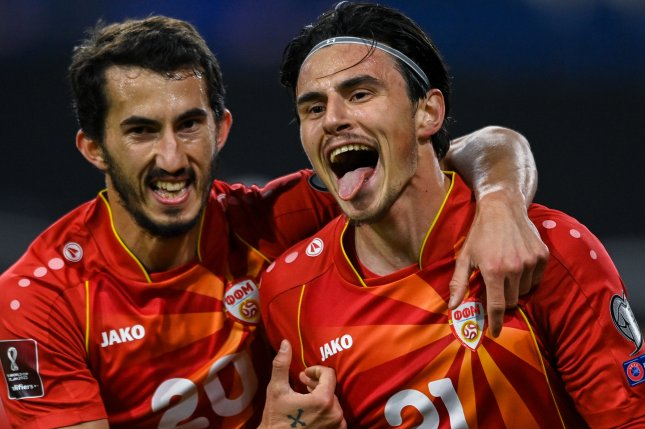 Left wing Eljif Elmas (R) beat goalie Marc-Andre ter Stegen in the 63rd minute to lead North Macedonia to a win over Germany in a World Cup qualifier Wednesday in Duisburg, Germany. Photo by Sascha Steinbach/EPA-EFE