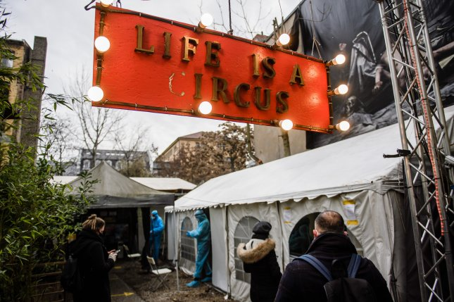 People wait for a COVID-19 test in the yard of the KitKatClub in Berlin, Germany, o Friday. The club has been closed as a result of coronavirus restrictions, and now serves as a testing center. Photo by Cl;emens Bilan/EPA-EFE