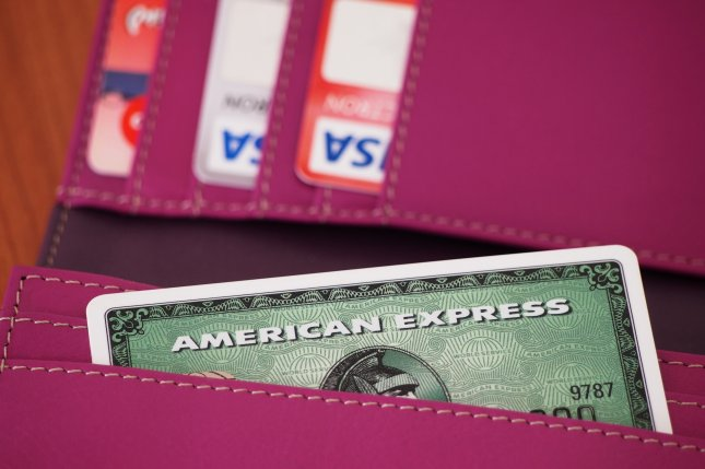 This month, all four major credit card companies -- Visa, Mastercard, American Express and Discover -- eliminated their signature requirements for purchases. As greater technology emerges, institutions and banks are looking for more secure ways to authorize payments and deter theft. File Photo by Nadalina/Shutterstock/UPI