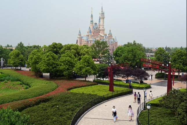 Visitors walk Monday through the Shanghai Disneyland theme park, which has reopened after a prolonged closure due to the coronavirus pandemic, in Shanghai, China. Photo by Zhou You/EPA-EFE