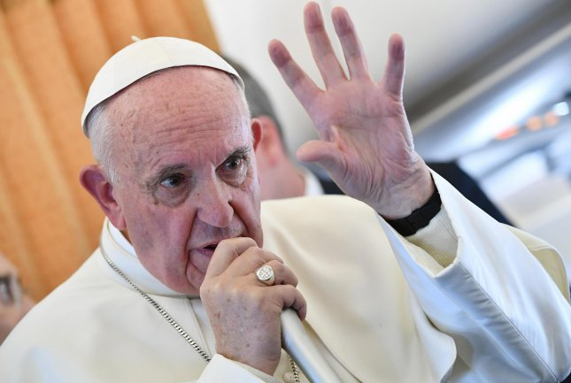Pope Francis, aboard a plane on November 1. In an interview Tuesday with the Belgian Catholic publication Tertio, the pope compared the effects of media disinformation to coprophilia, an interest in feces. Photo by Ettore Ferrari/European Presphoto Agency/UPI