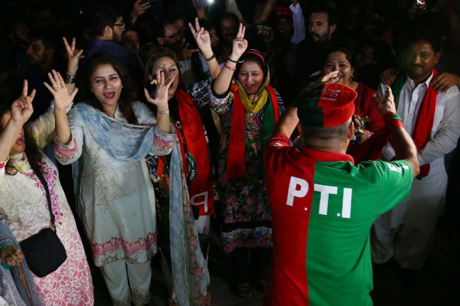 Supporters of Imran Khan, head of Pakistan Tehreek-e-Insaf (PTI) party celebrate in Karachi, Pakistan, on Thursday. On Friday, the political party of Pakistan's former prime minister Nawaz Sharif accepted defeat despite saying the election was rigged. Photo by Shahzaib Akber/EPA-EFE