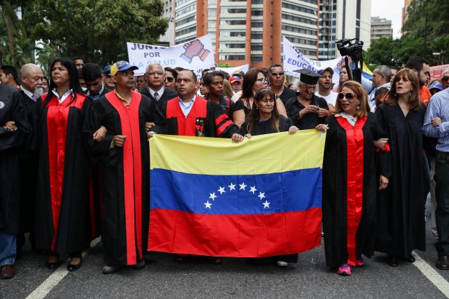 Lawyers participate in a protest against Nicolas Maduro's government in Caracas, Venezuela, on September 26.  Photo by Rayner Pena/EPA-EFE