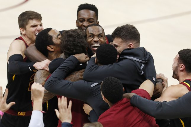 LeBron James (C) of the Cleveland Cavaliers celebrates with teammates after making the game winning shot to defeat the Indiana Pacers during the second half of Game 5 of the Eastern Conference first round playoffs Wednesday at Quicken Loans Arena in Cleveland, Ohio. Photo by David Maxwell/EPA-EFE