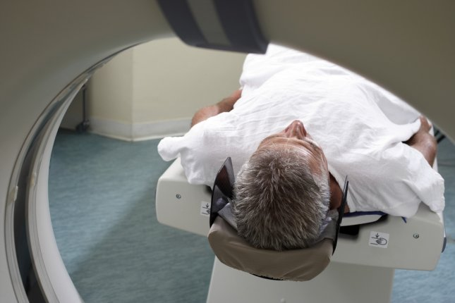 A patient in an MRI machine. Scientists have discovered a way to block certain proteins from brain tumors to keep them from growing or spreading. Photo by Volt Collection/Shutterstock