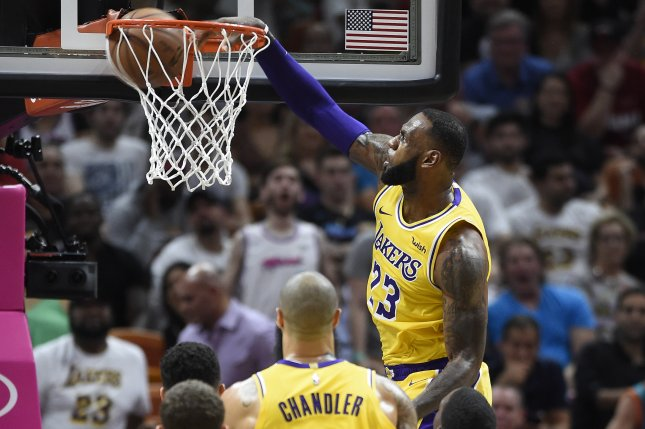 1af818a26de Watch  Lakers  LeBron James crushes Heat with vicious dunks - UPI.com