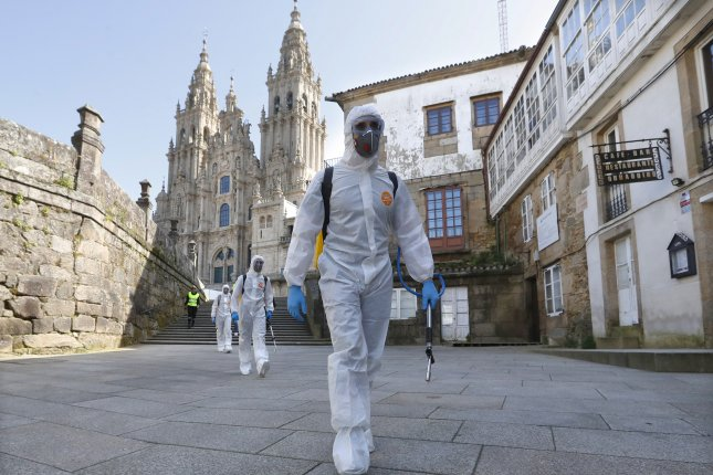 Military personnel in protective suits disinfect streets on Wednesday in Santiago de Compostela, Spain. The nation is in its fourth day of public confinement to stem the spread of the coronavirus. Photo by Lavandeira Jr/EPA-EFE