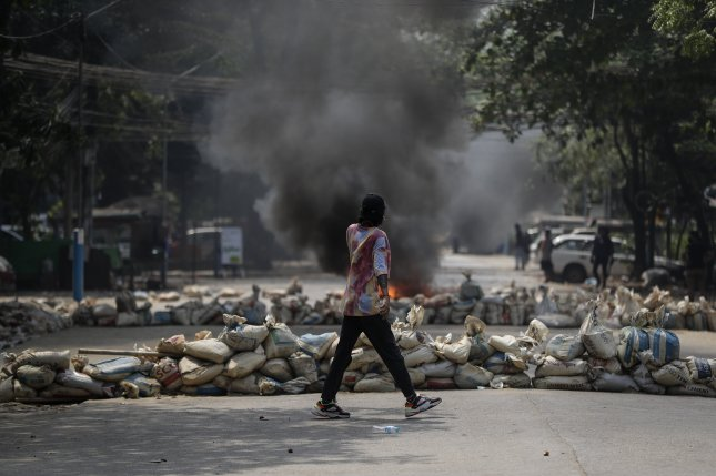 A demonstrator walks near a barricade during an opposition protest against the military coup in Yangon, Myanmar, on March 27. File Photo by EPA-EFE
