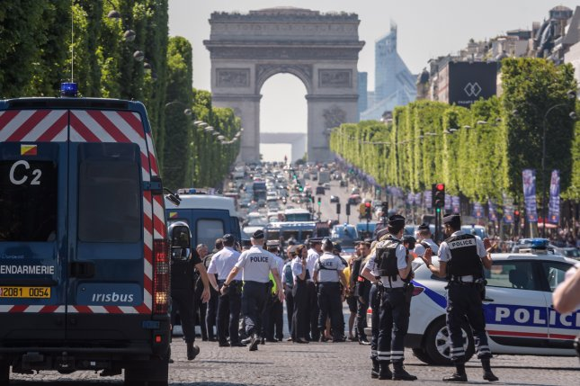Authorities said a man rammed his vehicle into a police convoy on the Avenue des Champs-Élysées on Monday in what was termed a botched suicide attack. The suspect was killed but no one else was injured. Photo by Christophe Petit Tesson