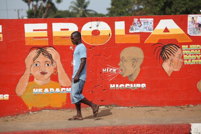 A Liberian man walks past an ebola awareness painting on a wall in downtown Monrovia, Liberia, in 2015. File Photo by Ahmed Jallanzo/EPA