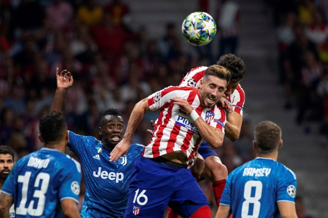 Atletico's Hector Herrera (C) stopped Juventus from earning a victory in the first game of their 2019-2020 Champions League campaign with a score in the 90th minute Wednesday in Madrid. Photo by Rodrigo Jimenez/EPA-EFE