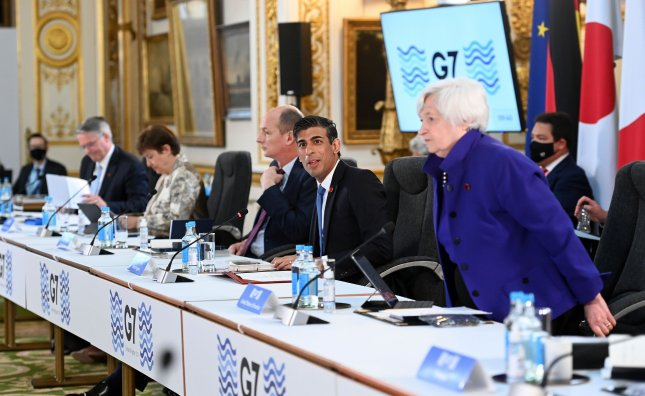 British Finance Minister Rishi Sunak (2-R) welcomes G7 Finance Ministers to Lancaster House Friday during the G7 Finance Ministers meeting in London. Photo by Andy Rain/EPA-EFE