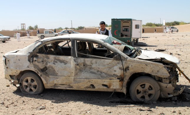 Afghan security officials inspect the scene of a suicide bomb attack October 10 at a police station in Lashkar Gah, the provincial capital of restive Helmand province, Afghanistan. U.S. Army Gen. Curtis Scaparrotti, who also serves as NATO's Supreme Allied Commander in Europe, told the Senate Committee on Armed Services on Thursday that Russia may be giving material support to the Taliban in Afghanistan. Russia dismissed the accusations. File Photo by Watan Yar/EPA