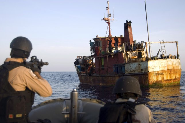 Members of a U.S. Navy visit, board, search and seizure team from the guided-missile cruiser USS Gettysburg, and U.S. Coast Guard Tactical Law Enforcement Team South, Detachment 409, capture suspected pirates in the Combined Maritime Forces area of responsibility on May 13, 2009. Pirates hijacked oil tanker Aris 13 on Tuesday and are currently demanding ransom for the crew's release, according to the European Union's anti-piracy naval force. Photo by MC1 Eric L. Beauregard/EPA
