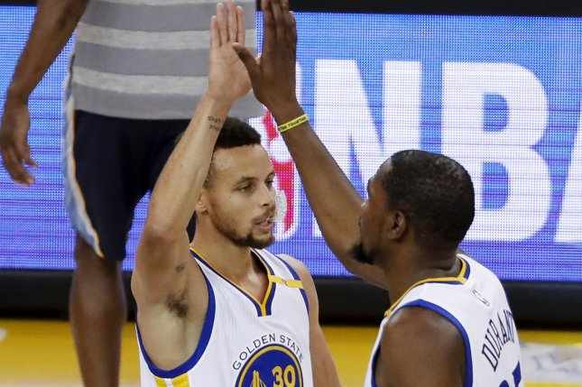 Golden State Warriors forward Kevin Durant (R) is greeted by Golden State Warriors guard Stephen Curry (L) after Durant scored a three point jumper. File photo by John G. Mabanglo/EPA