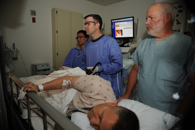 Medical personnel perform a colonoscopy at Naval Medical Center San Diego. A study found there were greater increases in colon cancer screening rates in states that expanded Medicaid than in those that did not. Photo by Mass Communication Spec.t 2nd Class Chad A. Bascom/U.S. Navy