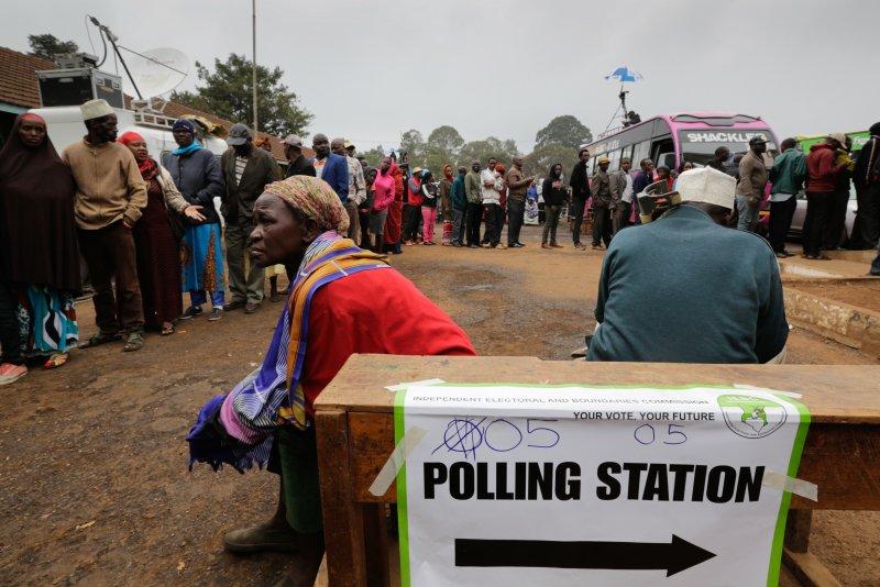 Kenyan voters gather to cast their votes at a polling station in Nairobi, Kenya, on Tuesday. President Uhuru Kenyatta is being challenged by popular opposition leader Raila Odinga. Photo by Daniel Irungu/EPA