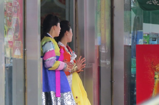 North Korean women stand in front of the door of a North Korean restaurant in the northeastern Chinese city of Shenyang. Defectors in South Korea suffer from worsening health, according to data from the South Korean government. Photo by Yonhap News Service/UPI