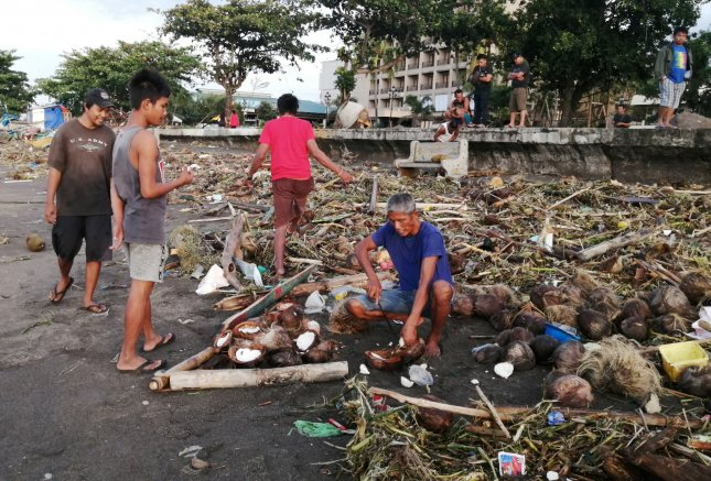 Villagers clear debris in the typhoon-hit city of Ormoc, Philippines, Wednesday. Photo by Robert Dejon/EPA-EFE