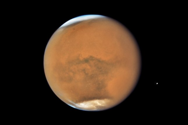 NASA's Hubble Space Telescope photographed Mars in July 2018, near its closest approach to Earth since 2003. Photo by NASA/ESA/STScI