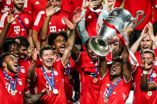 Bayern Munich's Kingsley Coman (R) holds the trophy after his club defeated Paris Saint-Germain in the UEFA Champions League final on Sunday at Luz Stadium in Lisbon, Portugal. Photo by Jose Sena Goulao/EPA-EFE