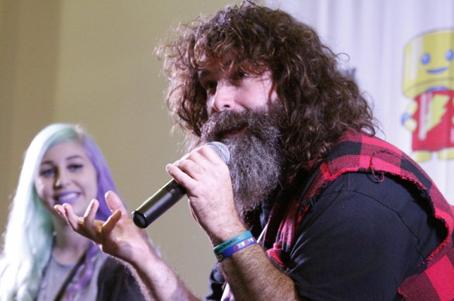 Pro wrestler Mick Foley (R) has tested positive for COVID-19. File Photo by Super Festivals/Wikimedia Commons
