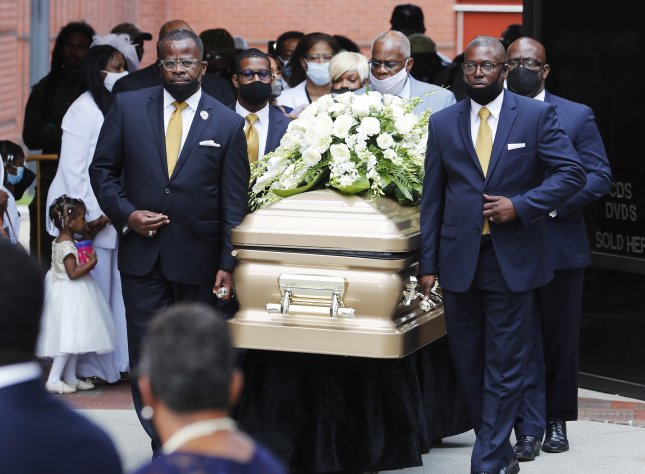 Tomika Miller, the widow of Rayshard Brooks, follows the casket as it is carried out of the church at the end of his funeral Tuesday at Ebenezer Baptist Church in Atlanta. Photo by Erik S. Lesser/EPA-EFE
