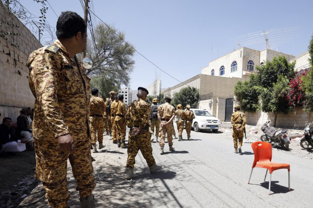 Yemeni security forces stand guard in Sana'a, Yemen, on Saturday. Demonstrators included members of the national security forces, who say they have not been paid in nine months. Photo by Yahya Arhab/EPA-EFE