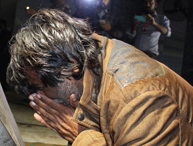 A man reacts after a suicide bomb attack targeted devotees at the shrine of Sufi Muslim saint Lal Shahbaz Qalandar in Sehwan, Pakistan, on Thursday. Dozens of people were killed and more than 250 injured in the incident. Photo by Waqar Hussain/EPA