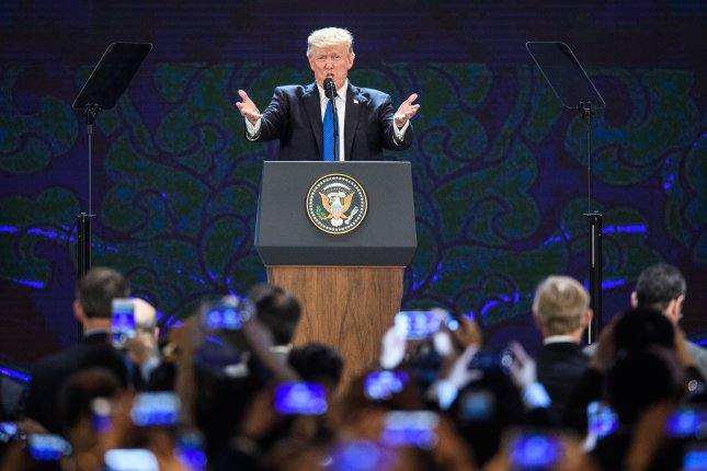 U.S. President Donald Trump speaks on the final day of the APEC CEO Summit in Danang, Vietnam, on Friday. Pool Photo by Anthony Wallace/EPA-EFE