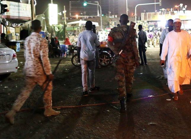 Sudanese soldiers walk in a street leading to the sit-in site near the military headquarters in Khartoum, Sudan, where Sudanese military forces violently dispersed demonstrators, resulting in at least 35 people dead. Photo by Amel Pain/EPA-EFE