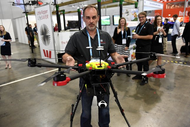 Dragan Skvaric from The Ripper Group holds one of the company's drones at the World of Drones Congress in Brisbane, Australia, in August. Just hours after the drone, named Westpac Little Ripper Lifesaver, was unveiled for a trial run in Australia it helped rescue two teens struggling in heavy surf off the coast of New South Wales. Photo by Dan Peled/EPA-EFE