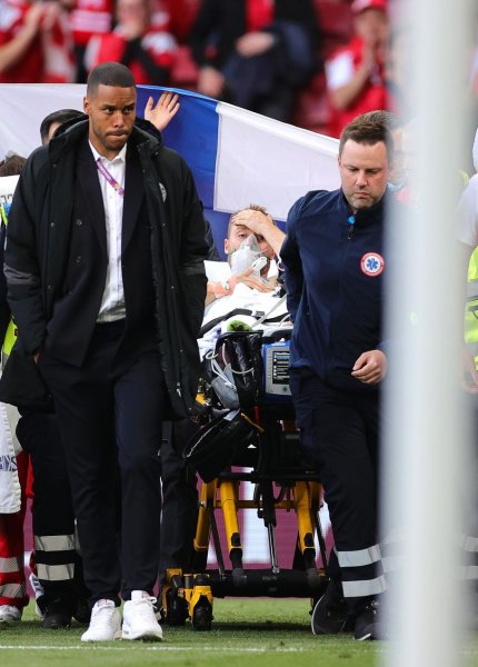 Christian Eriksen (C) of Denmark is stretchered off the pitch Saturday after receiving medical assistance during the UEFA EURO 2020 group B preliminary round soccer match between Denmark and Finland in Copenhagen, Denmark. Photo by Friedemann Vogel/EPA-EFE
