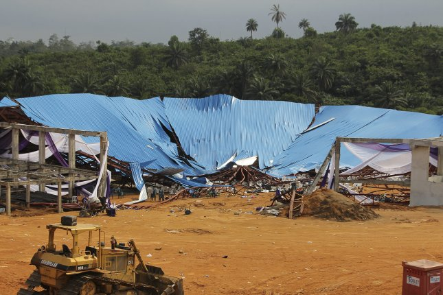 The roof of the partially constructed Reigners Bible Church in Uyo, Nigeria, collapsed Saturday, killing at least 200 people, according to a hospital official. Photo by Tife Owolabi/European Pressphoto Agency