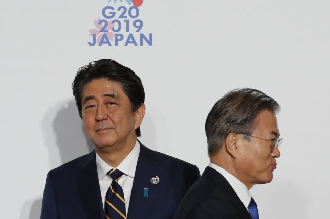 South Korean President Moon Jae-in (R) has called on Japan to end export control measures targeting South Korean tech firms. File Photo by Kim Kyung-hoon/EPA-EFE