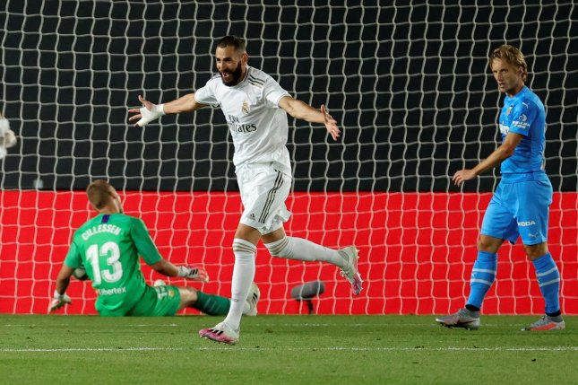 Real Madrid striker Karim Benzema (C) scored his squad's first and third goal in a 3-0 win against Valencia Thursday in Madrid. Photo by Juanjo Martin/EPA-EFE