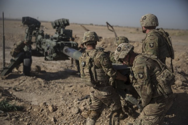 U.S. Soldiers with Task Force Iron maneuver an M-777 howitzer so it can be towed into position at Bost Airfield, Afghanistan, on June 10, 2017. On Thursday, the U.S. military announced Aaron Butler, a member of the Utah National Guard, was killed in action. Photo by Sgt. Justin T. Updegraff/U.S. Marine Corps /UPI