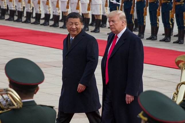 U.S. President Donald Trump and Chinese President Xi Jinping review soldiers at the Great Hall of the People in Beijing, China,on November 9, 2017. File Photo by Roman Pilipey/EPA-EFE