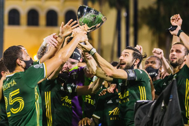 The Portland Timbers beat Orlando City SC 2-1 to win the 2020 MLS Is Back Tournament final Tuesday in Orlando, Fla. Photo courtesy of Jared Martinez/Matt Stith/Devin L'Amoreaux/MLS