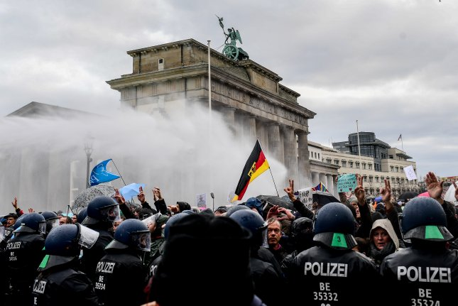 Police in Germany said 200 people were arrested during protest against government restrictions to prevent the spread of COVID-19. Photo by Filip Singer/EPA-EFE