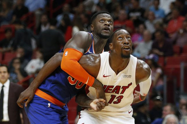 Miami Heat star Bam Adebayo (R) is on pace to become the sixth NBA player since 1980 to record at least 15 points, 10 rebounds, five blocks, one steal and one block per game in a single season. Photo by Rhona Wise/EPA-EFE