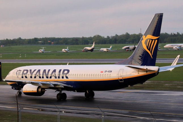 A Ryanair Boeing 737-800 is seen at Vilnius International Airport in Vilnius, Lithuania, on Sunday. A Ryanair flight from Athens to Vilnius was diverted to the Belarusian capital of Minsk under the escort of a fighter jet after its crew was notified by authorities of a 'potential security threat on board.' Photo by EPA-EFE