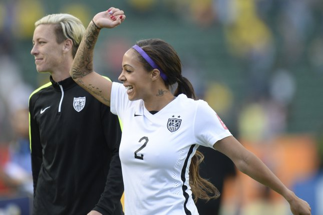 Abby Wambach (L) and Sydney Leroux of USA wave to fans after a 2015 FIFA Women's World Cup round of 16 in Edmonton, Canada. Photo by Mike Sturk/EPA