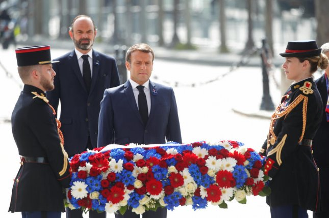 French President Emanuel Macron (C) and Prime Minister Edouard Philippe lay a wreath during a ceremony Friday marking the 75th anniversary of VE Day in Paris, France. Photo by Charles Paltiau/EPA-EFE
