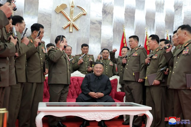 North Korean leader Kim Jong Un (C) distributed commemorative pistols to senior officers in the military, state media said Monday. Photo by KCNA/EPA-EFE